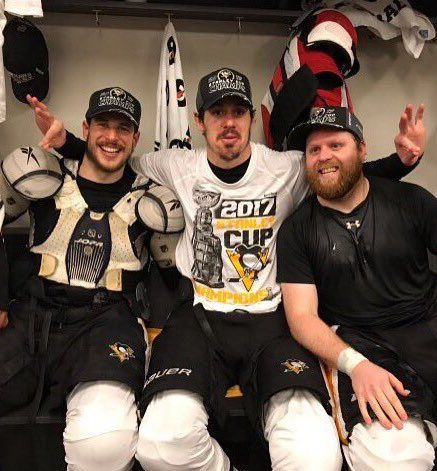 Sidney Crosby, Evgeni Malkin, and Phil Kessel celebrate in the locker room after winning the 2017 Stanley Cup