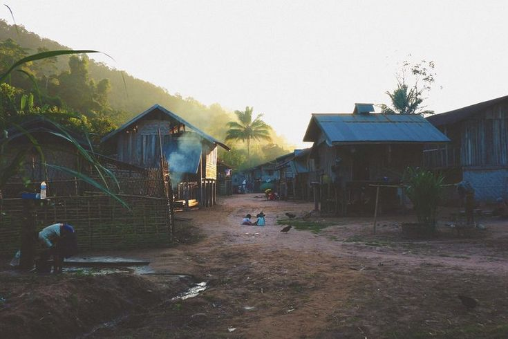 Village in the jungle in the Nam Ha national park in Laos near Luang Namtha. by Studio Mali