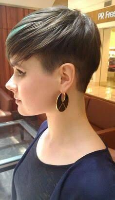 Women's two block (undercut) hairstyle with blue highlights