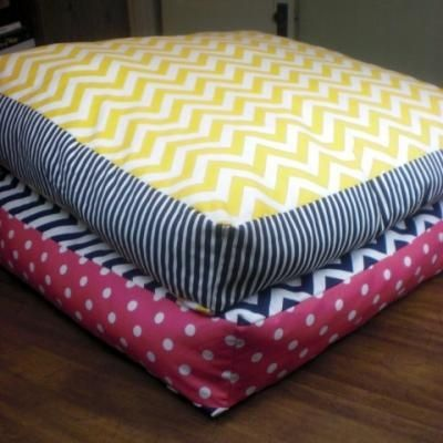 Giant Floor Pillows DIY {Home Accessories} This would be cool for downstairs mom. Like when we have family movie nights or sleepover or something. A little extra seating for us kiddos. and we could just get bean bag beans.