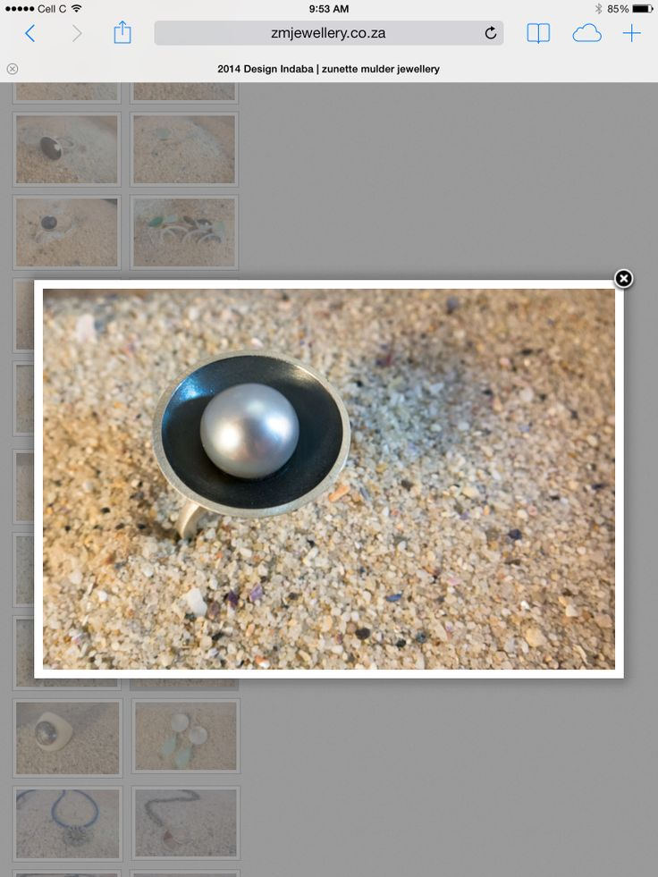 Big grey pearl in oxidized silver bowl and matt finished ring