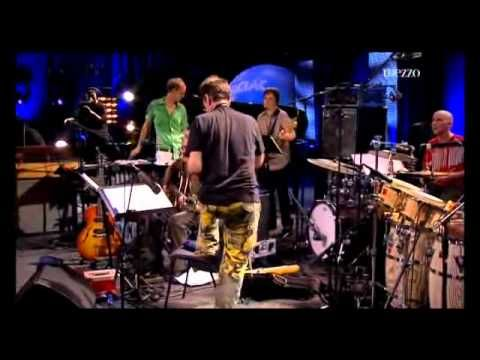 John Zorn - Jazz in Marciac - Live 2010 (Full Show).  John Zorn - direction, saxophone Marc Ribot - guitar Jamie Saft - piano, orgue Trevor Dunn - bass Kenny Wollesen - vibraphone Joey Baron - drums Cyro Baptista - percussion