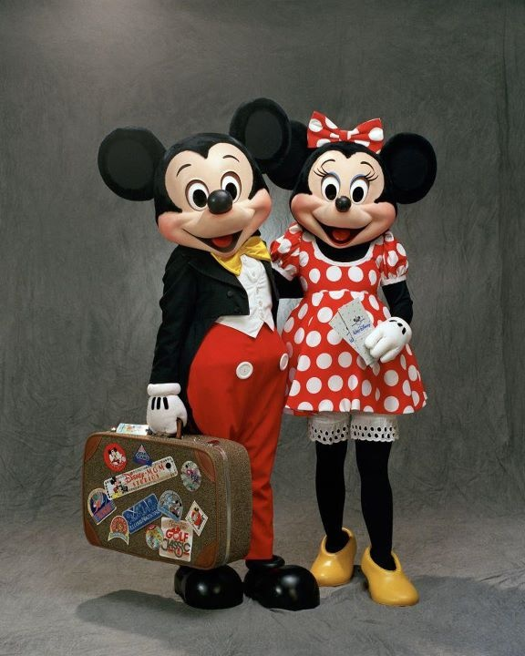 Mickey & Minnie Mouse traveling for the Holidays.