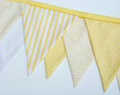 Yellow bunting banner for Jude Briley's nursery from Nestables etsy shop