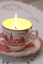 A red and white antique cup candle for the Holidays.