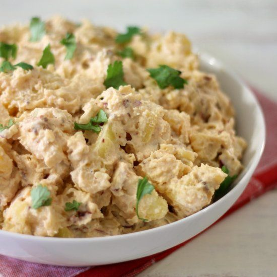 A creamy, rich, lightened up potato salad with a kick of heat from the chipotle peppers and chock full of little bits of bacon.