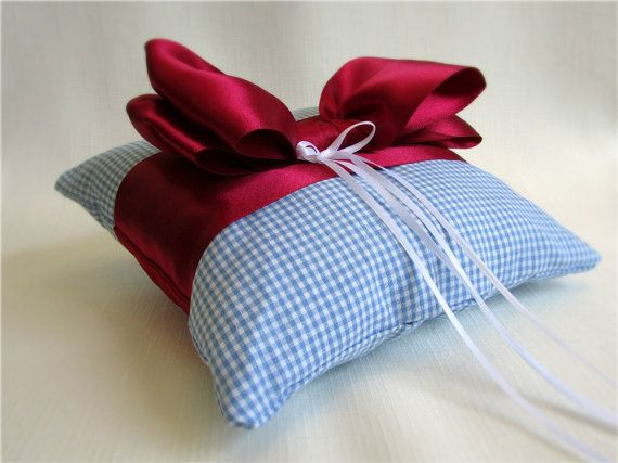 Over the Rainbow Ring Bearer Pillow - Blue and white gingham ring cushion with a ruby red satin bow. Perfect for a Wizard of Oz themed event. #wizardofoz #ruby #dorothy