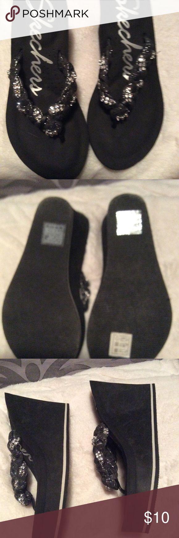 Women's size 7 Skechers wedge flip flop Women's size 7 black wedge flip flop sandals. Made by Skechers. Worn a few times. Good condition. Skechers Shoes Wedges