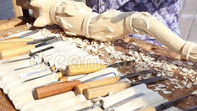 Craftsman carving wood - ancient dacian flag.