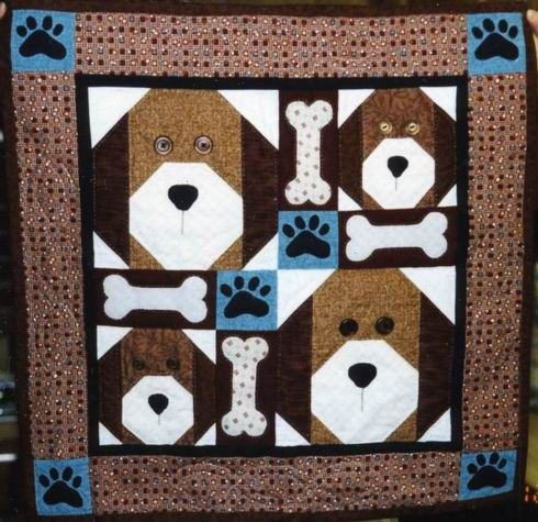 Brown Dog faces on a Quilt