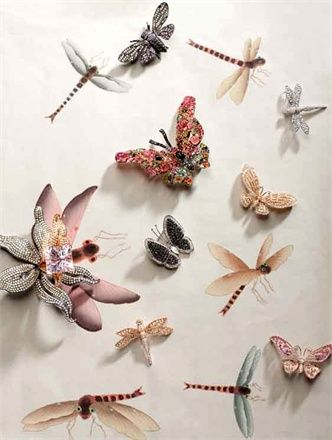Multicolored butterflies form a transient effect as they gracefully fill the wall'Vogue with misha handmadewallpaper'