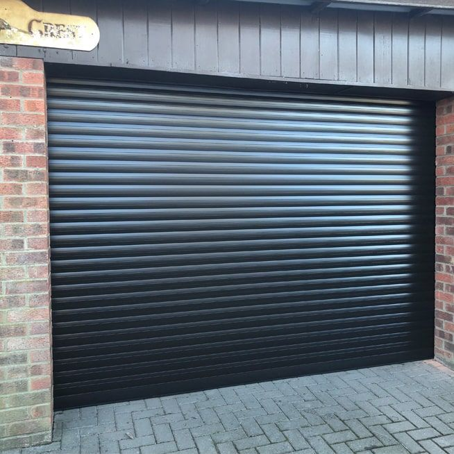 Roller Garage Doors In Black From Garolla Are Stylish Secure And Come With An Amazing Servic