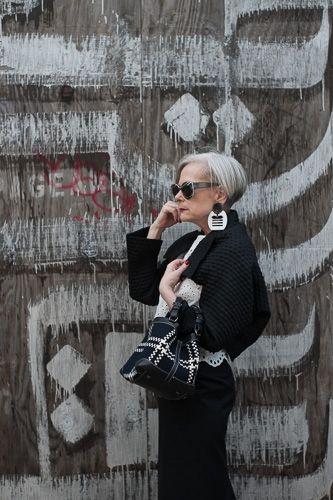 Accidental Icon Wears  White Eyelet Top: Zara, Long pencil skirt: Yohji Yamamoto, Textured Bolero:  Isabel Toledo, Bag: Caroline De Marchi Cubo, Shoes: Steven by Steve Madden,  Tuxedo Earrings: Dawn's Vintage, Sunglasses: The Optical Boutique