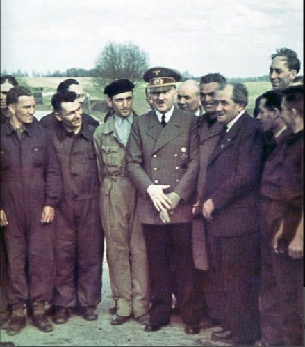 """Real color photo of Hitler with Ferdinand Porsche in 1940. Hitler is often (erroneously) described as """"short."""" He was actually above average height for the time, being 5′9, or 1.76 meters."""