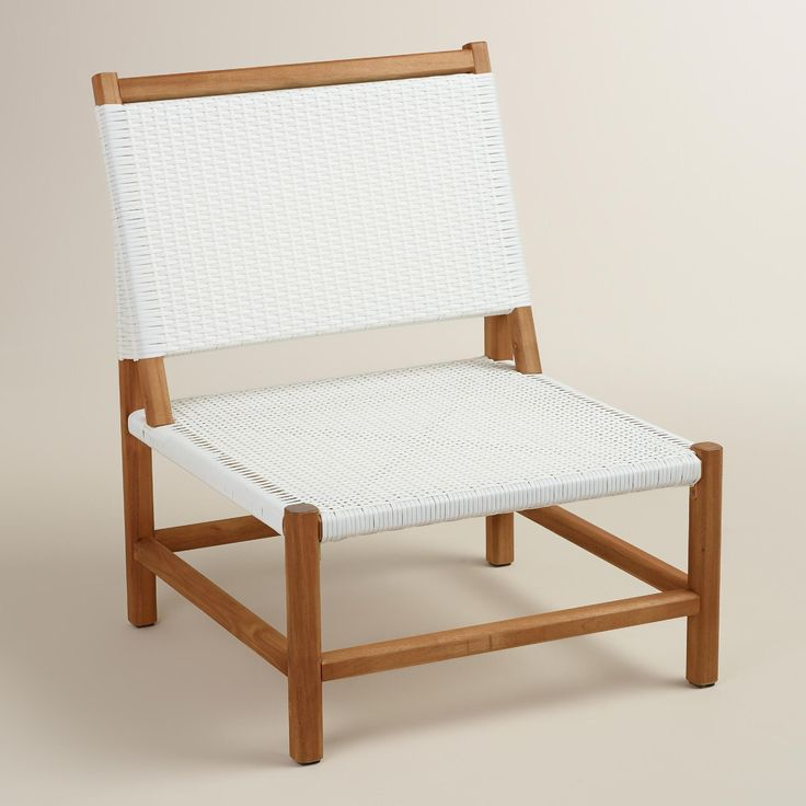 Combining woven white resin and acacia wood, our chair captures the casual luxury found on the coasts of Italy. www.worldmarket.com #WorldMarket Outdoor Entertaining
