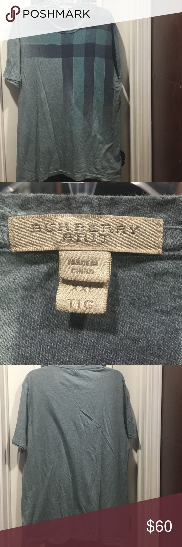 Burberry Brit t-shirt for men Burberry Brit T-shirt for men. Size XXL.  Very soft material. 100% cotton. This item is worn no tears just a small white mark on the back of the shirt at the bottom see pic. Don't know what it is. But very light and small. Burberry Shirts Tees - Short Sleeve