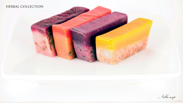 Herbal collection of soaps is a great example of using herbs in soap making - rose petals, chamomile, lavender buds and calendula.