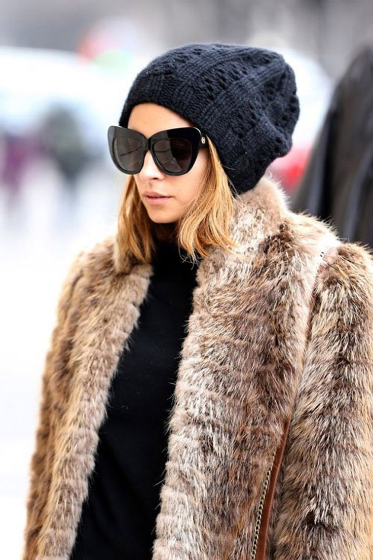 Mixing a casual bobble hat with a glamorous fur jacket makes a divine combo.