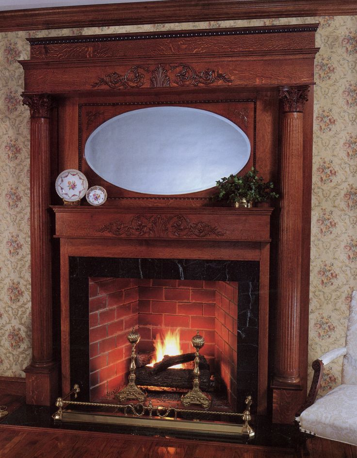 inspiring traditional fireplace mantel with unique wooden panel and great oval mirror and beautiful white floral
