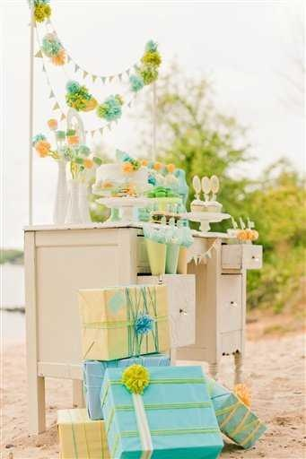 Becca Bond Photography-This undated publicity photo provided by Anders Ruff shows designers and stylists Maureen Anders and Adria Ruff� use of a palette of mint, aqua, yellow and lime green for a gender neutral baby shower in Tega Cay, S.C. Incorporating handmade elements like wool pompoms, simple printable paper decor, and using paper, marshmallows and cake decorations as centerpiece �lowers,�is an inexpensive and creative way to cr