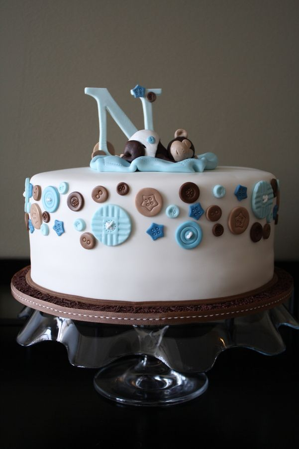 This cake was fondant covered with gumpaste buttons and a 50/50 gumpaste fondant monkey! The large gumpaste button (one on the back of the ...
