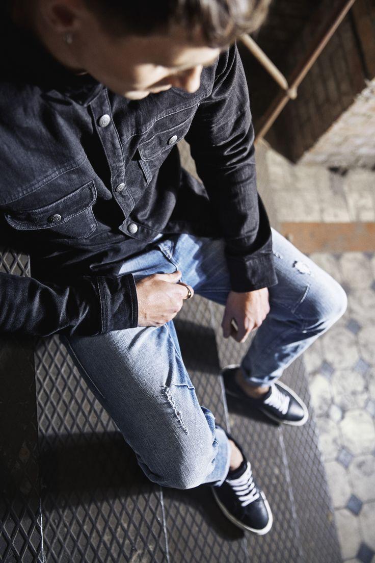 Outfit ideas for men: Dark blue slim fit denim jacket, ripped light blue denim jeans and black sneakers   JACK & JONES