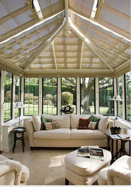Sun room with shade blinds in case the sun is too strong. Great idea ...