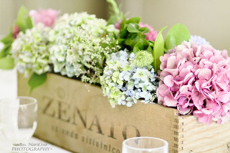 Put cups in the box to hold the flowers. Maybe paint the box and put the theme quote on it: