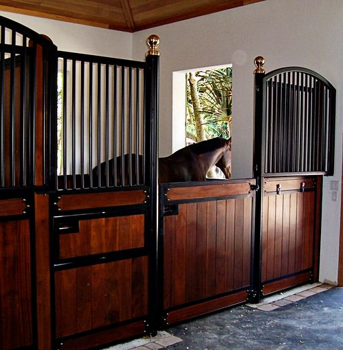 High Stall Front 6: Stall design with bar top; wood bottom; Euro-style center and bottom rails; Dutch-style door; swivel feeder and integrated water lines; and brass ball finials.