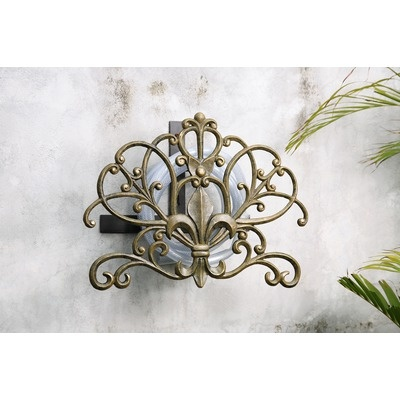 Over the bed crown (draped fabric).  Home Fleur de Lis Hose Holder