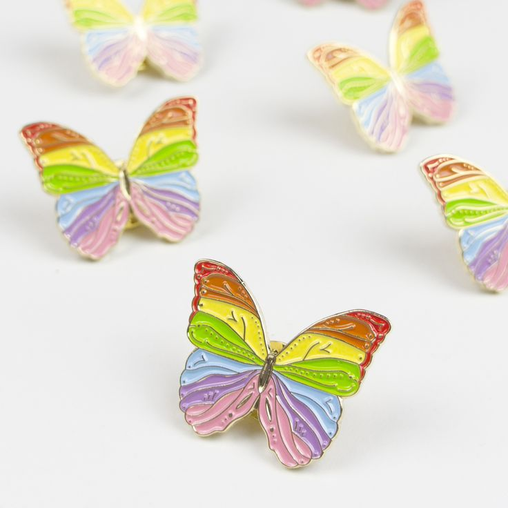 A gold and rainbow coloured soft enamel butterfly pin. Made from high quality materials for a super luxe finish.