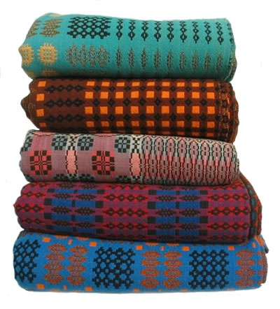 welsh blankets provided in the bedrooms and on sofa by fire... rich colour and of course warmth!