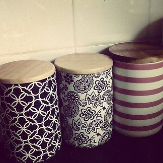 Use paint, contact paper, or patterned duct tape to update these bright kitchen canisters.