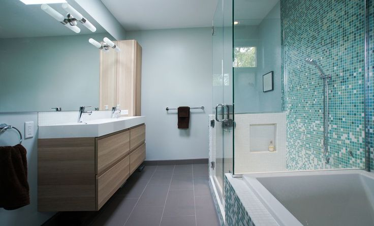 Contemporary Master Bathroom with Wall sconce, frameless showerdoor, limestone tile floors, Large Ceramic Tile, Double sink
