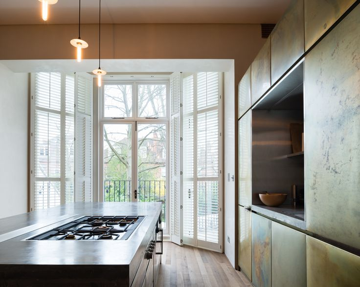 Refurbishment of terraced home in Belsize Park, London.   Kitchen.   Materials. Detail. Patinated Brass. Concrete. Interior Design.   Solid Timber Floor by Ted Todd. Polished Plaster by Calfe Crimmings. Joinery by Goldcrest of London. Photographer - Jim Stephenson. Contractor - Mallett Construction.
