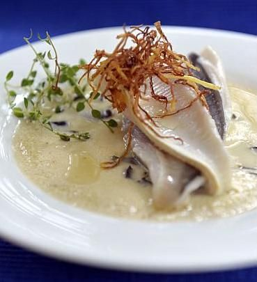 Recipe: steamed fish on savoury custard from cookbook author Sylvia Tan. More cooking tips at http://www.straitstimes.com/recipes-food-cooking-tips Photo: Desmond Foo/The Straits Times
