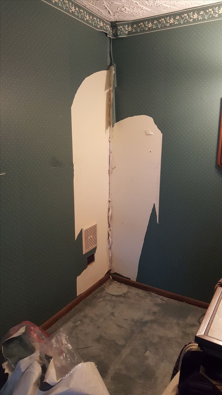 Wallpaper removal. Damage from room sinking, on posts. 100 gallon aquarium was located here.
