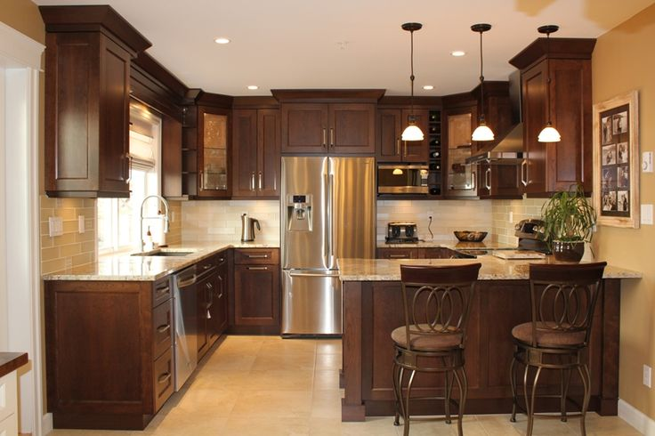 Light ceramic floor, darker cabinets, light counter tops North Vancouver Townhouse Kitchen Remodel