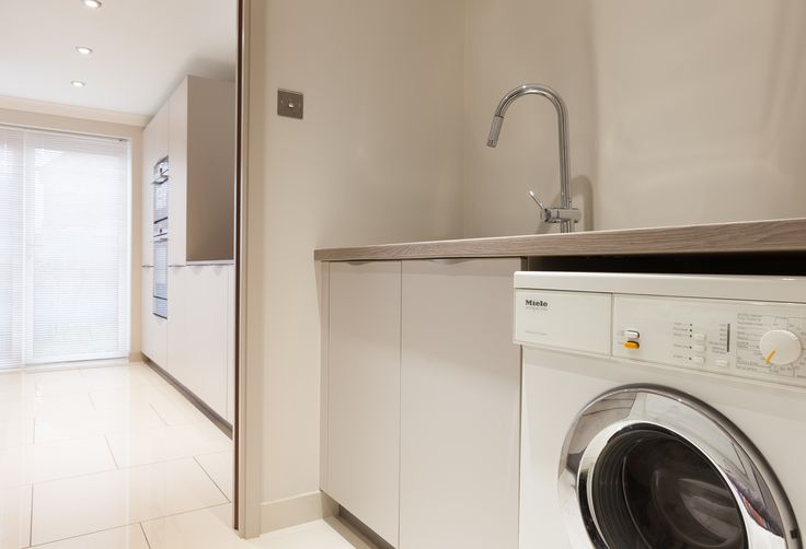 Space was borrowed from the back of the adjoining garage to create a much needed utility room