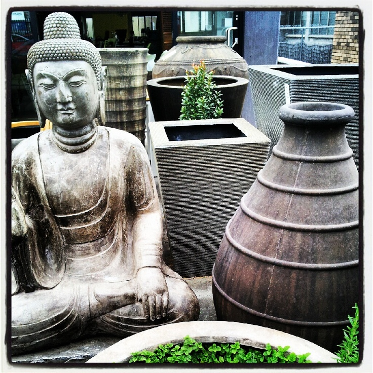 Life sized Stone Buddha and various Rustic Pots in the courtyard