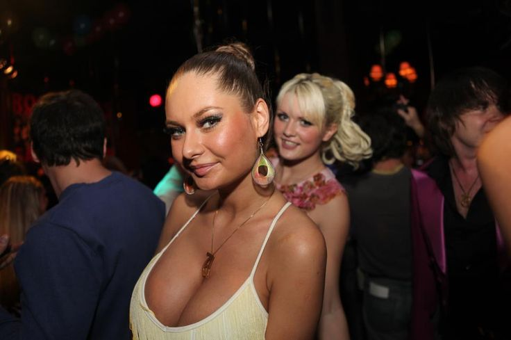 WOW what a dress and all that cleavage at the Disco with another model