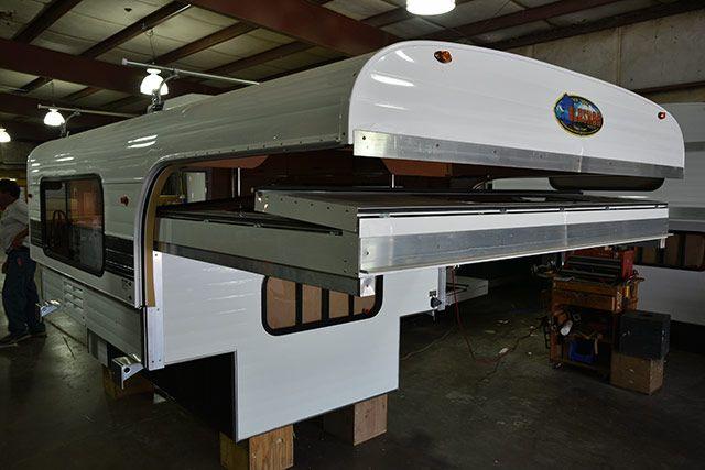 Truck Camper Magazine looks at a 2016 Alaskan 7 hard side pop-up truck camper designed for short-bed trucks in this descriptive Alaskan Camper review.
