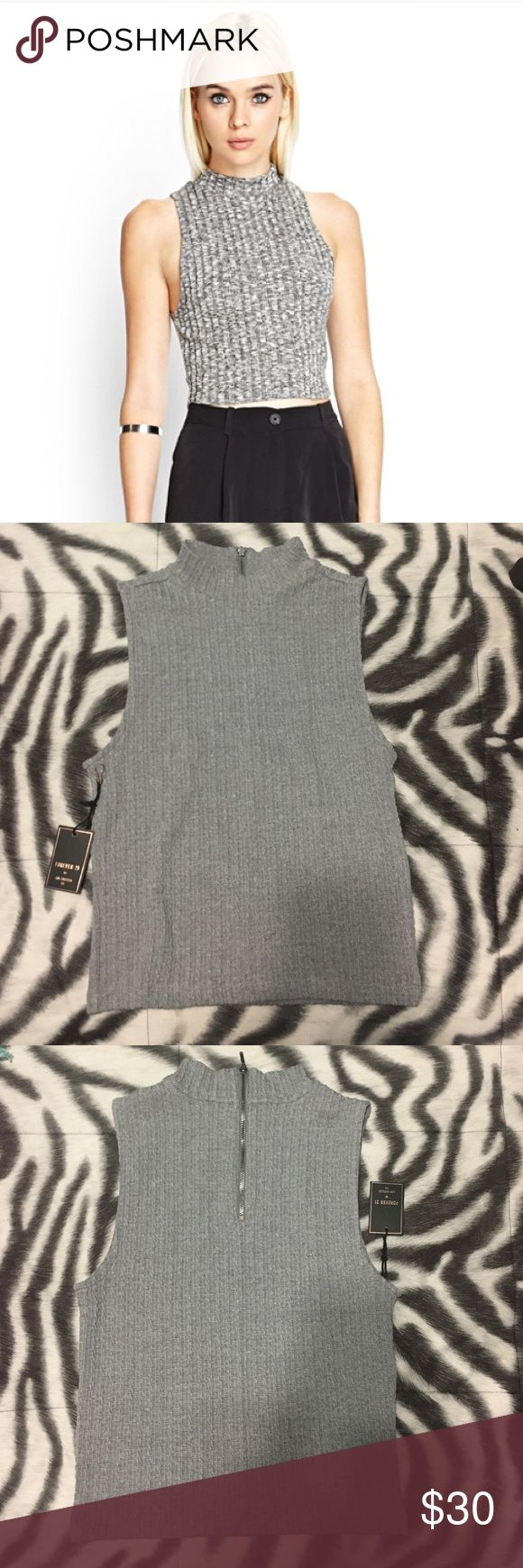 NWT Forever21 cropped sweater tank New and perfect condition, couldn't find exact picture online but VERY similar, just a darker gray color. Has somewhat of a turtle neck and a cute zipper in the back. Very cute for casual wear or even some leather leggings or dark jeans with heels for a night out. Selling only because I am short torso so it didn't fit the way I wanted it to. Forever 21 Tops Crop Tops