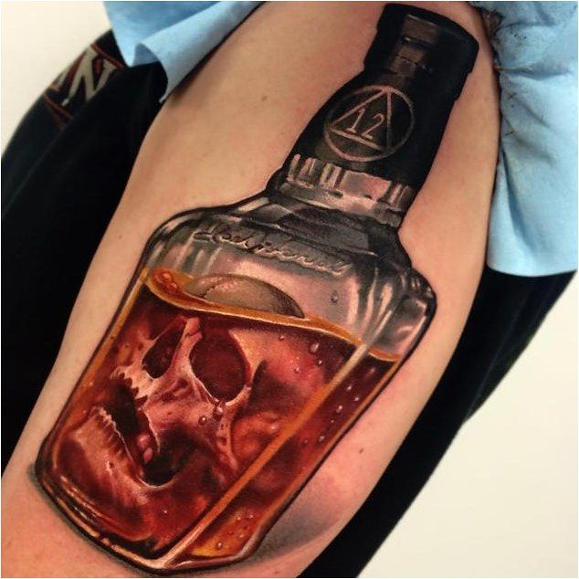 Tattoo Whiskey Bottle Tattoo By Jesse Rix Click To See More Skull Tattoo Circle Tattoos Bottle Tattoo