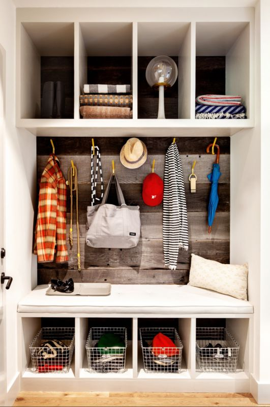 Converted Closet - If you are lucky enough to have a small closet off of your entry, don't bog it down with a boring old dowel and hanging coats. Create a mudroom that is both useful and attractive. A small bench lends a bit of seating, and creative organizers, like felt baskets and hanging wire bins, keep every little item in place.