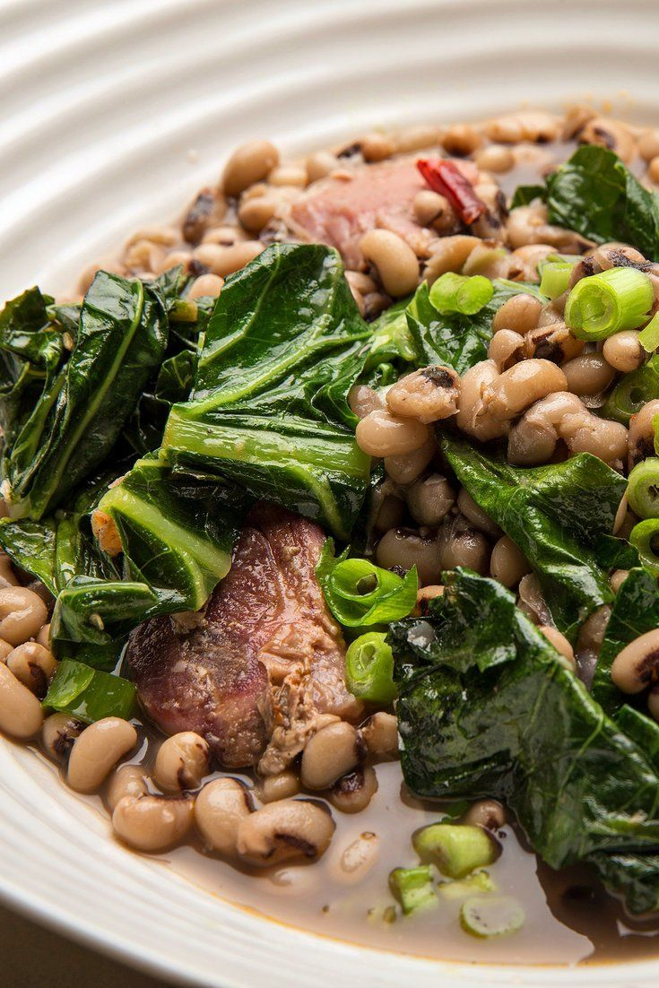 NYT Cooking: For the New Year's good fortune, a plate of black-eyed peas or other beans is considered auspicious, auguring wealth and prosperity. In the American South, they are traditionally eaten on the first day of the year. Adding cooked greens (the color of money) is said to make them even luckier. Simmered with onion and a meaty ham bone (other options are salt pork, bacon,%2...