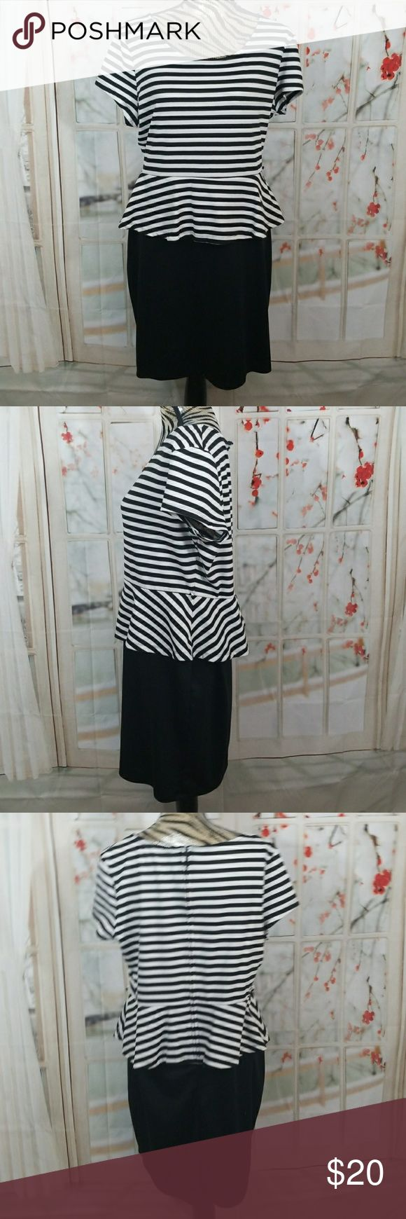 Black and white peplum dress Black and white striped top solid black bottom  Zips up back Had loops for a belt No size tag but fits like size 18 Armpit to armpit is approximately 23 inches Dresses