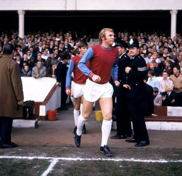 West Ham United captain Bobby Moore is pictured  leading his team out at Boleyn
