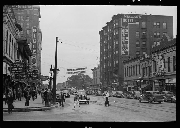 Sign across main street, Peoria, Illinois. 1938 May. Library of Congress.