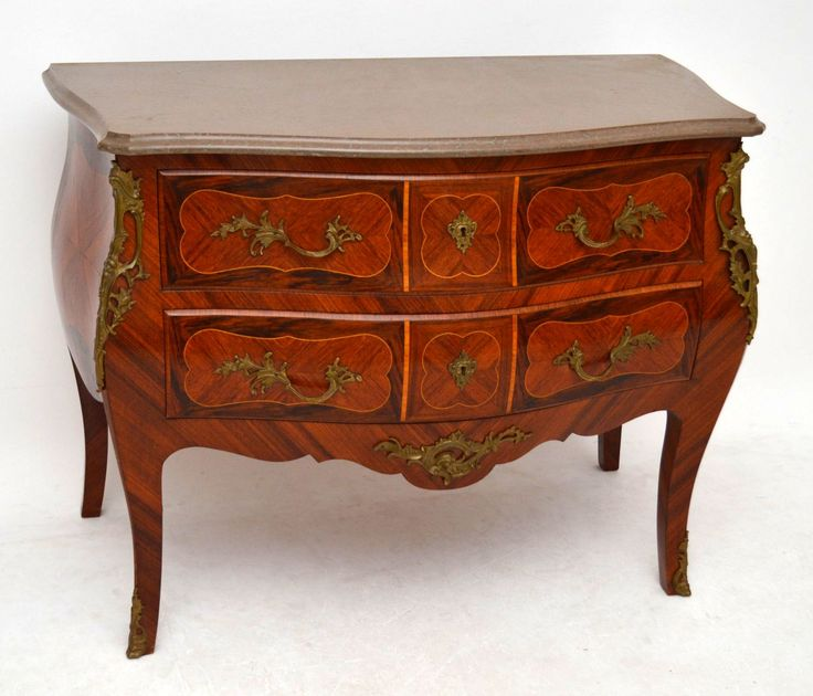 Very impressive antique Swedish Bombe commode chest which is in lovely condition. There are a few woods involved like Rosewood, Kingwood & other woods. It's also finely inlaid & there are probably some other woods within this piece. This commode has a marble top which is also in good condition. It has gilt bronze mounts, handles & escutcheons, which are naturally aged. This piece has stunning panels all over & dates around 1890-1910 period.